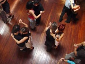 Group of people social dancing in a club.